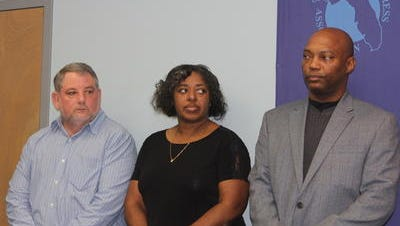 Doyal Hester, left, Gwendolyn Forehand and Darryl Newman, right, were all fired for their handling of the 911 call in the ambush death of Leon County Deputy  Chris Smith.