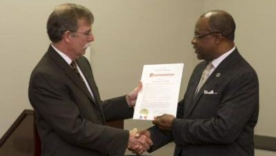 Hattiesburg Mayor Johnny DuPree, right, presented Dr. Tim Rehner, director of the School of Social Work at The University of Southern Mississippi, with a proclamation recognizing March 2015 as National Social Work Month on March 4.