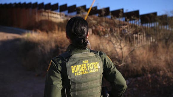 A Border Patrol agent near the fence outside Nogales,