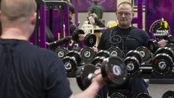 John Jeffery works out at the new Planet Fitness in