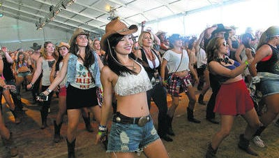 Stagecoach fans dance.
