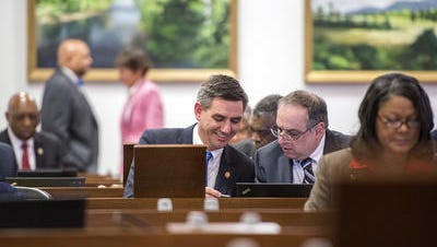 Rep. Brian Turner, D-Buncombe, confers with another legislator on the floor of the state House earlier this year.