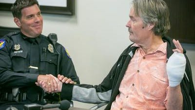 Phoenix police officer Richard DiCarlo helped Thomas Goodwin when he noticed he was living on the street with an infected hand and took him to Medical Respite Center at Circle the City in Phoenix on Tuesday, May 19, 2015.