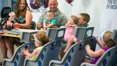Roxanna and her husband Staff Sgt. Michael Hoffman with their quintuplets and son one year after they were born at University Medical Center Phoenix - Banner Health in Phoenix on Tuesday, June 2, 2015.