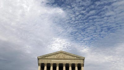 The U.S. Supreme Court and (pictured above it) a higher power.