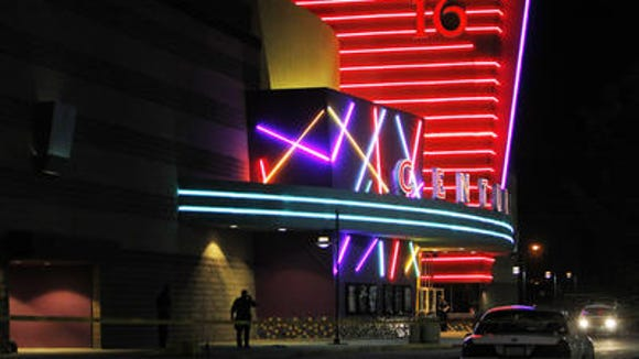 In this July 20, 2012 file photo, police are pictured outside of a Century 16 movie theatre where James Holmes killed 12 people and wounded 70.