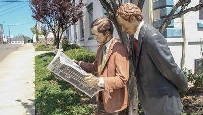 """Secondhand News,"" a life-size bronze sculpture by artist  Seward Johnson, is one of 20 sculptures located in downtown Toms River. They will be there through Sept. 10. This one is on Robbins Street."