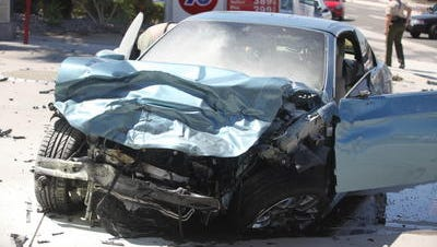 A BMW was destroyed after crashing into a Ford Focus on Highway 111 in Rancho Mirage two years ago. The Ford's passenger died and the BMW's driver is charged with second-degree murder.