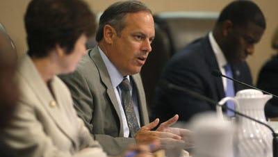 Commissioner Scott Maddox at Thursday night's budget vote.
