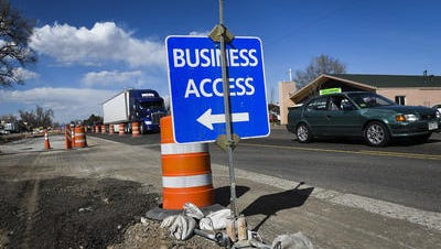 Road construction cones and sign.