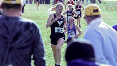 Tatnall's Jill Reinhardt completes the girls portion of  the Joe O'Neill Invitational Meet, Friday at Bellevue State Park in Wilmington.