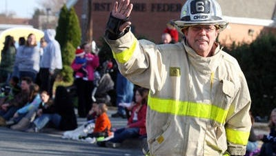 In this Dec. 2, 2012 photo, Parsonsburg Fire Chief Steve White skates down Mount Hermon Road in Salisbury in the city's Christmas parade. The Parsonsburg Fire Department said Thursday, Nov. 5, 2015, that White died   after a short illness.