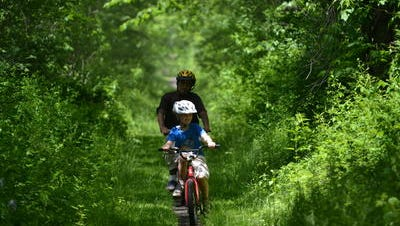 Two bikers on the Sussex Branch Trail.