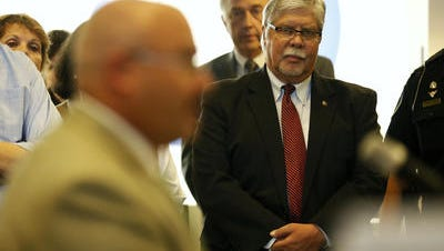 Springfield Mayor Bob Stephens looks on as Greene County Sheriff Jim Arnott speaks during an April press conference Stephens had called on the jail issue.