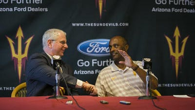 ASU swim coach Bob Bowman, left, signed four swimmers ranked in the top 100 nationally in his first recruiting class.