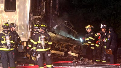 Firefighters examine the car that was struck by a Metro-North train in Valhalla Feb. 3.