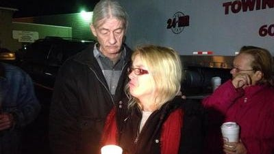Jackie Fiske lights a candle for her missing sister, Bambi Madden, during the annual vigil in 2014.