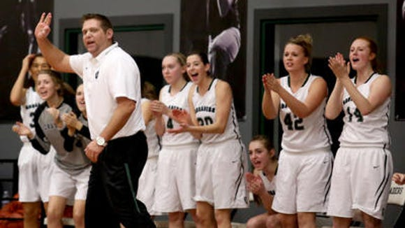 Salem Academy coach Ben Brown makes a call in front of Salem Academy's cheering bench.