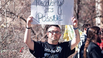 Joshua Trujillo from inside out recovery, paticpating in a peaceful protest at the state capital, on Jan. 30.