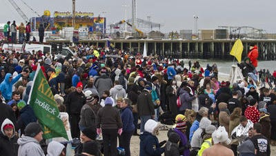 A crowd gathers on the beach last year before the annual Polar Bear Plunge in Seaside Heights.