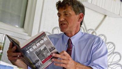 "Richard Fernicola holds his book, ""Twelve Days of Terror."""
