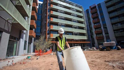 A worker works at the site of what will be Roosevelt Point, market-rate apartments in downtown Phoenix built in 2013 by the same company that is proposing a new student-housing complex in Fort Collins. Roosevelt Point is near the Arizona State University campus in downtown Phoenix.