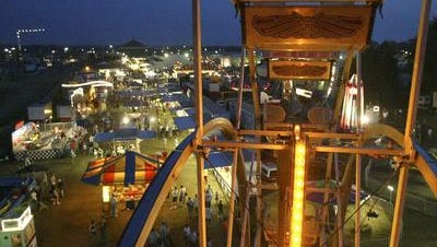 The lights of the midway illuminate the sky over a past Central Wisconsin State Fair.
