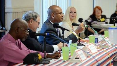 Brevard County Commission candidates, for left, Dwight Seigler, Ron Taylor, Randy Foster and Andrea Young answer questions during Thursday's candidate forum in Melbourne organized by the Space Coast Progressive Alliance.
