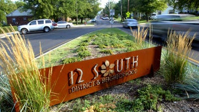 The 12th South district sign sits at the front of the new developments along 12th Avenue