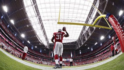 The Arizona Cardinals' David Johnson warms up before playing the San Francisco 49ers on Sep. 27, 2015 in Glendale. The Cardinals, the lone metro-Phoenix franchise to make the Forbes list of the top 50 sports teams globally, are worth an estimated $1.54 billion, according to Forbes, although that's below the NFL average of $2 billion.