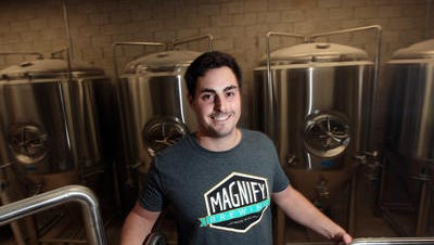Founder/President Eric Ruta, standing in front of fermenters at Magnify Brewing in Fairfield. April 2, 2015.