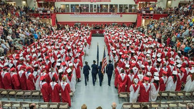 The AFJROTC honor guard advances for the Presentation of Colors during the Jeffersonville High School commencement ceremony in Jeffersonville, Ind. June 11, 2016
