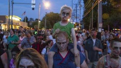 People made up as zombies -- the undead -- parade along Bardstown Road during the 2015 Zombie Walk.