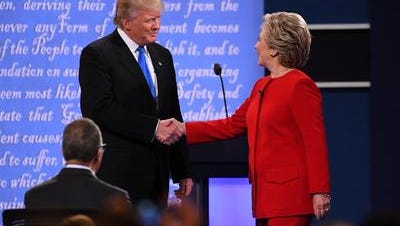 Democratic presidential candidate Hillary Clinton greets Republican presidential candidate Donald Trump on stage during the first presidential debate at Hofstra University.