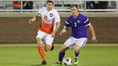 Clemson Tigers Austen Burnikel (20) battles for the ball Sunday against Albany in the NCAA sweet 16 at Historic Riggs Field.