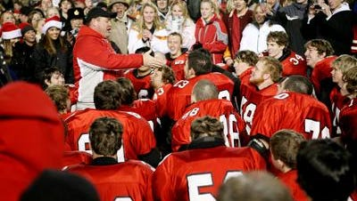 Riverheads football coach Robert Casto talks to his team following its state championship victory in 2006.