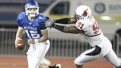 Former Ball State football player Robert Eddins pressures the Buffalo quarterback in 2010. Eddins was found dead Tuesday evening in Detroit.