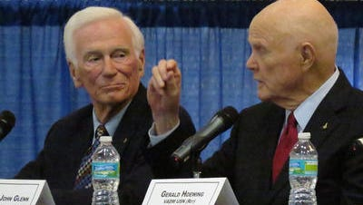 In this 2012 photo, Eugene Cernan,left, listens to fellow former astronaut John Glenn answer questions from the audience during a luncheon at the Pensacola Naval Aviation Museum. Cernan died Monday at age 82.