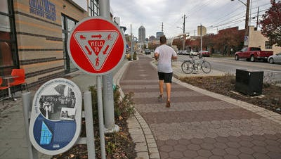 A jogger runs along the Cultural Trail on Virginia Avenue at McCarty Street.