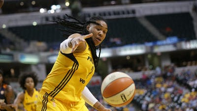 Erlana Larkins goes for a loose ball Saturday night at Bankers Life Fieldhouse.