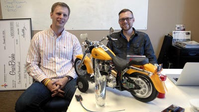 Entrepreneurs Jason Harrington, left, and Chris Bailey started a company that creates motorcycle safety gear. Their early development was fueled by a $100,000 prize from a program, the Vogt Awards, that recognizes innovative startup businesses.