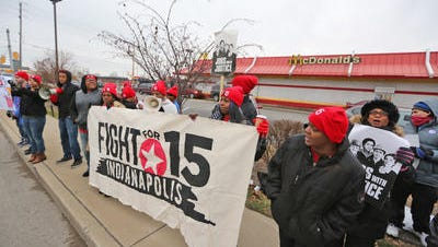 Workers rally for a $15 an  hour minimum wage outside an Indianapolis McDonald's in 2014.