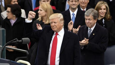 Donald Trump motions to the crowd after he was inaugurated as president of the United States on Jan. 20