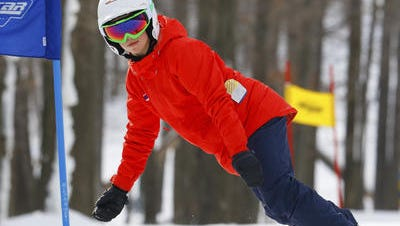 Snowboarder Daina Shilts, 27, Neillsville, practices for the Alpine & Snowboarding competition Saturday, Jan. 20, 2018, at the Granite Peak Ski Area in Wausau.
