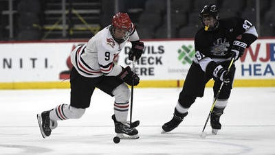 Hunterdon Central's Noah Motz (9) skates with pressure from Woodbridge Township's Dante Amato in the first period of the Public A final on Monday, March 5, 2018 at the Prudential Center.