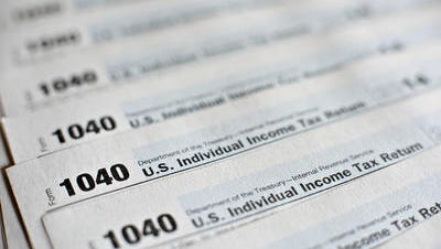 A Camden woman has admitted guilt in connection with a ring that collected large refunds with phony tax returns.