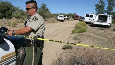 This 2006 photo shows a Riverside County sheriff's deputy at the scene of the Pinyon Pines triple murder. It happened Sept. 17, 2006.