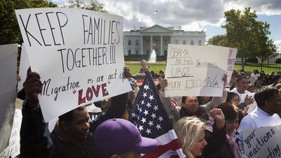 People rally for immigration reform outside the White House on Nov. 7.