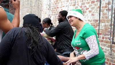 A volunteer helps provide warm clothing at the 2013 Christmas for the Homeless.