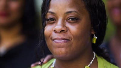 Shanesha Taylor smiles after being released from Maricopa County Jail, Friday, July 18, 2014.